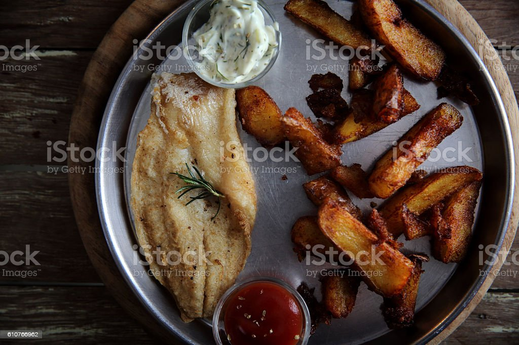 fish and chips on wooden background stock photo