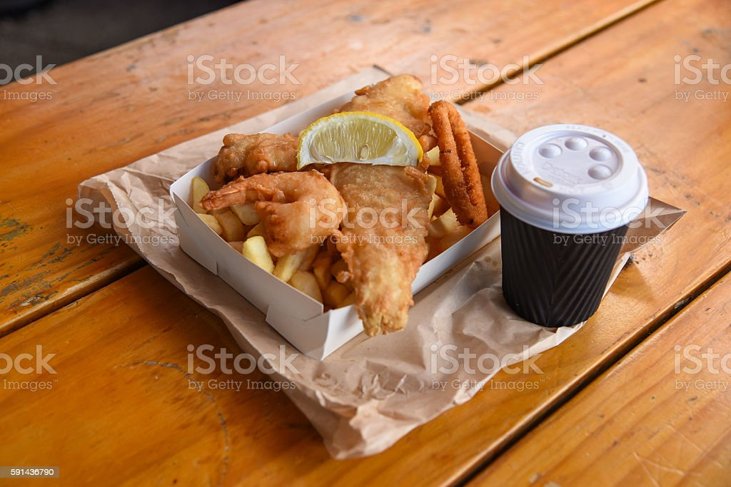 fish and chips with coffee stock photo