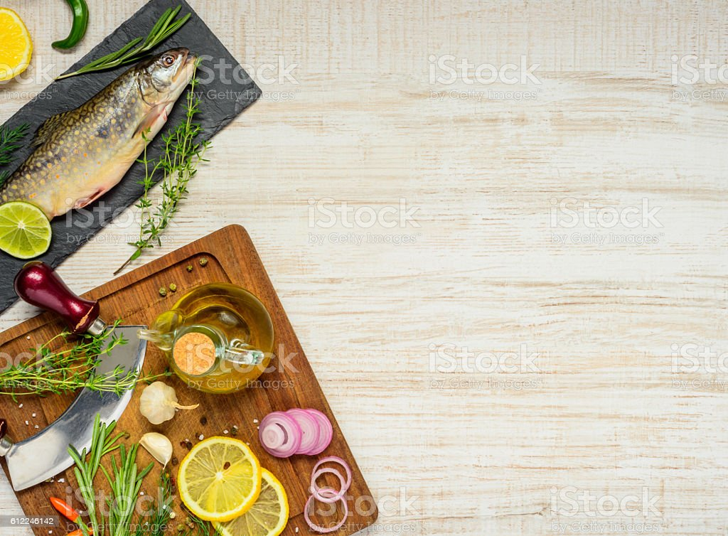 Fish And Cooking Ingredients on Copy Space Area stock photo