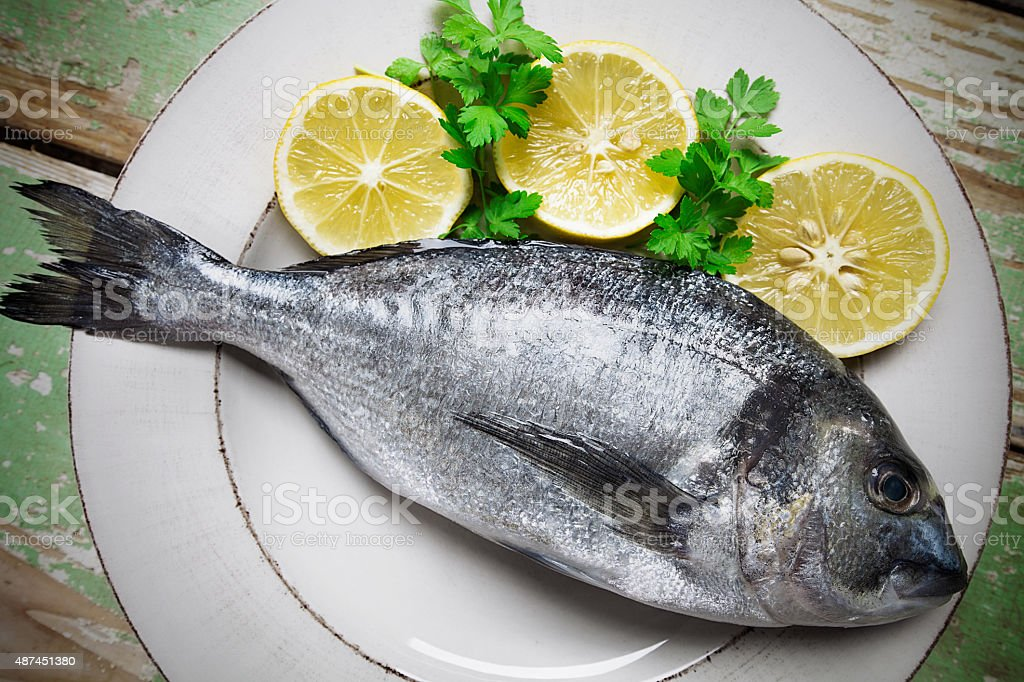 Fish and Lemon stock photo