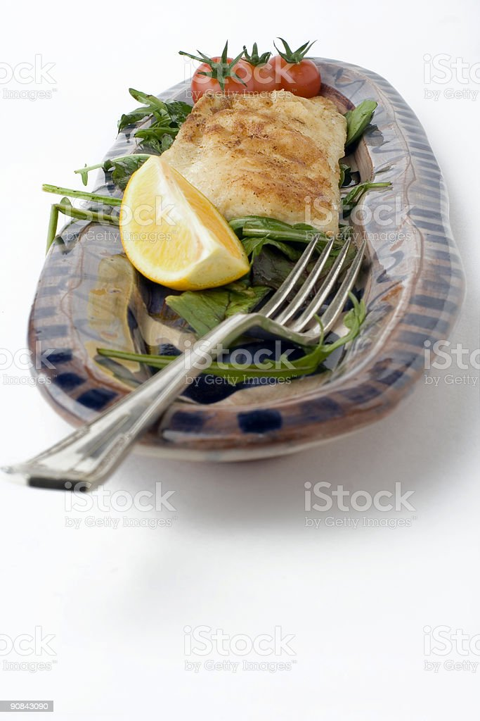 fish and salad on earthenware platter royalty-free stock photo