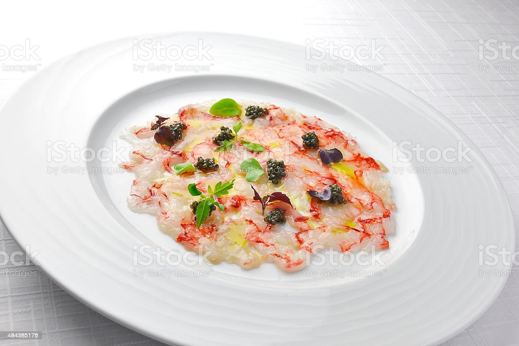 Fish Appetizer Carpaccio of Red Prawns and Caviar stock photo
