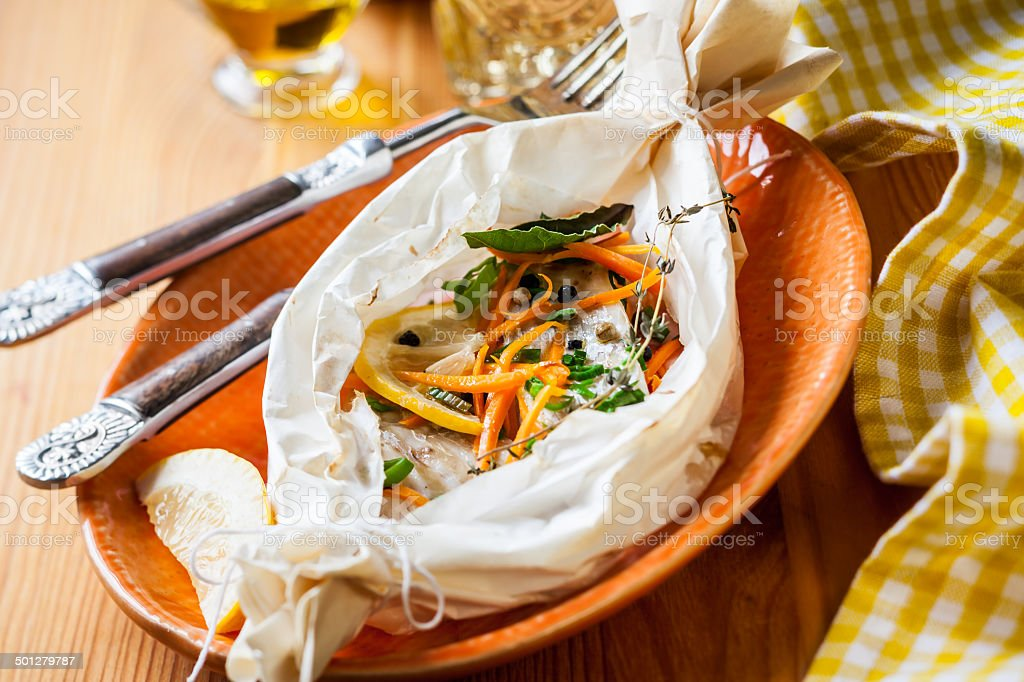 fish baked in parchment paper stock photo