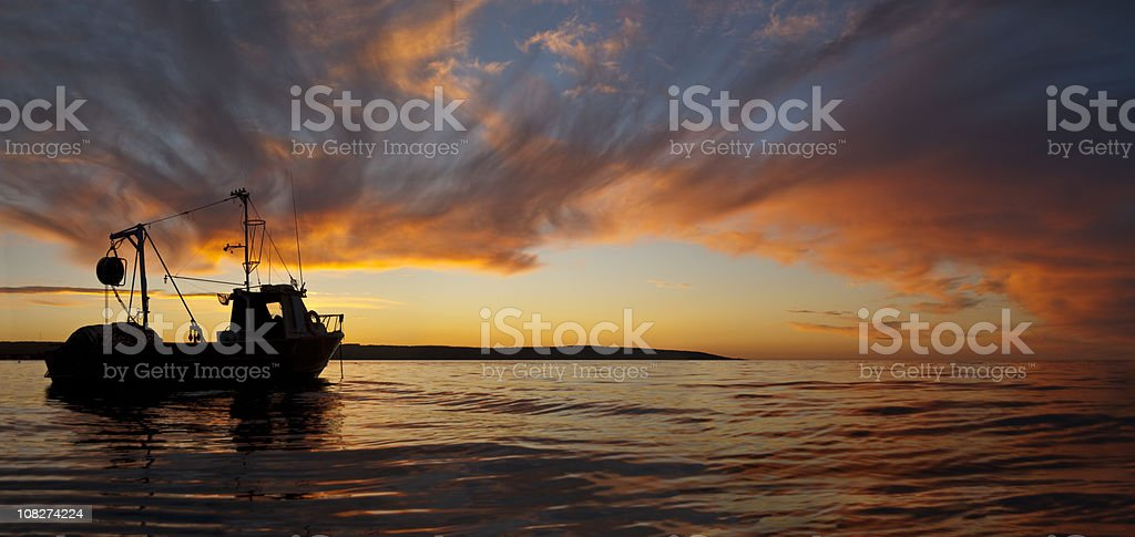 Fish Boat at Sunset Panorama stock photo