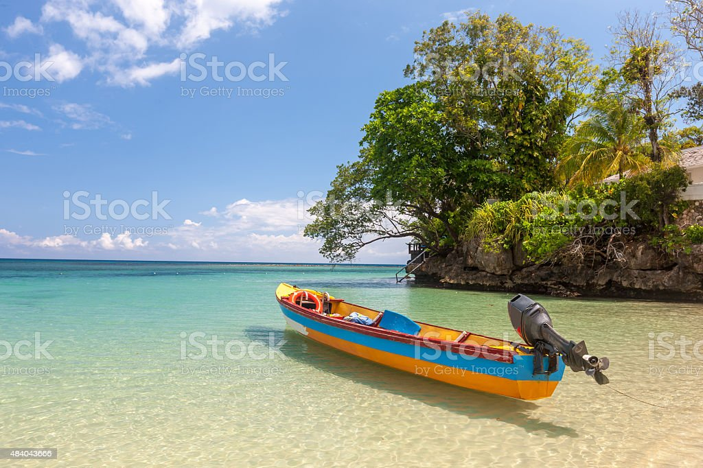 Fish boat on the paradise beach stock photo