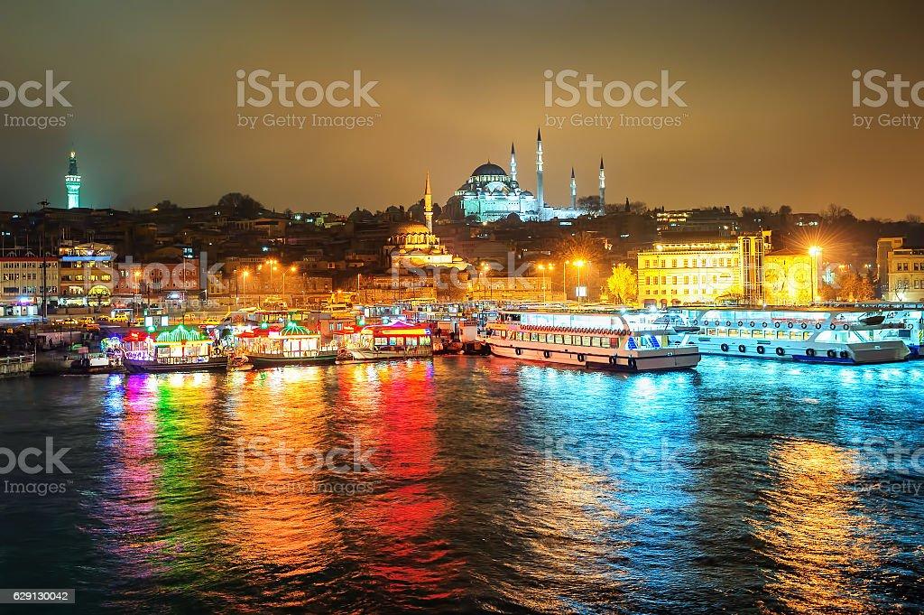Fish boat restaurants on Golden Horn at night, Istanbul, Turkey stock photo