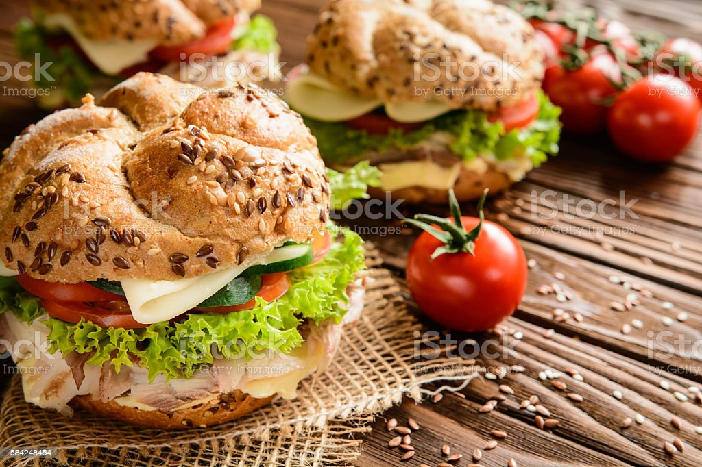 Fish burger with mackerel meat, cheese and fresh vegetable stock photo
