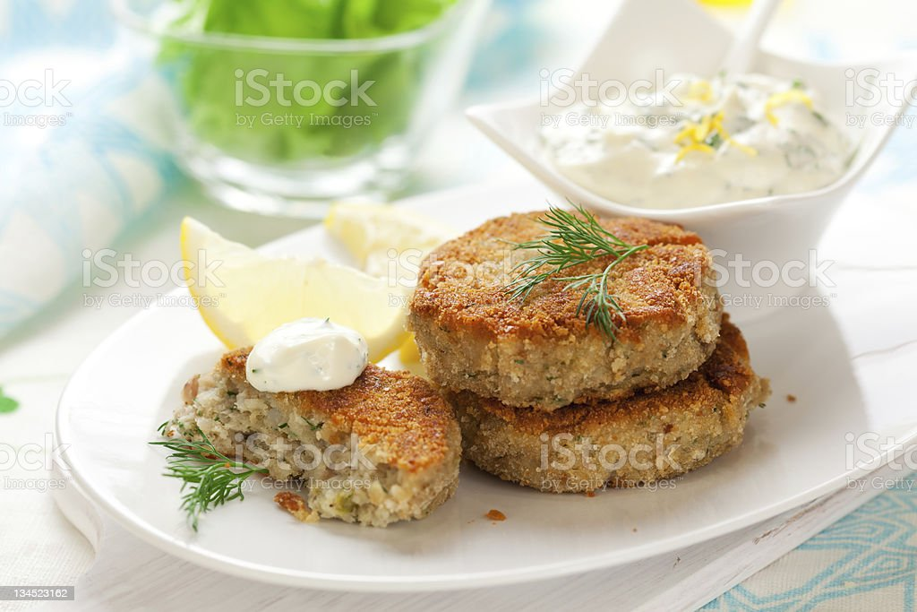COD fish cakes and tartar sauce stock photo
