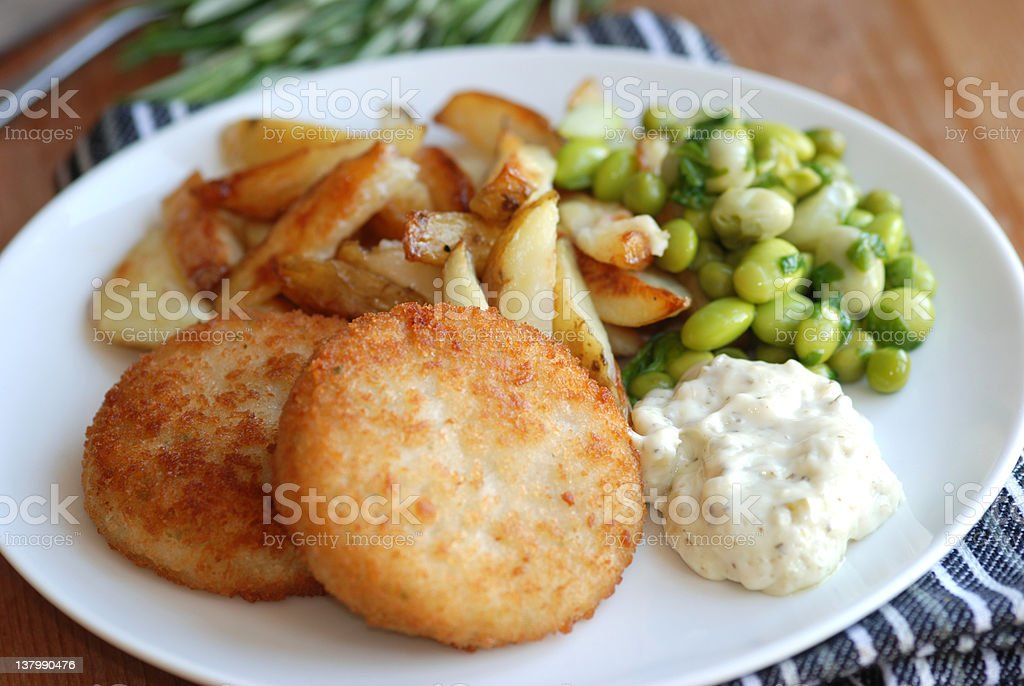 Fish cakes with chips stock photo