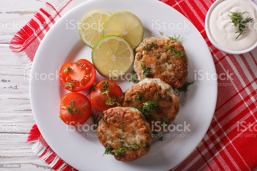 fish cakes with dill sauce on the table close-up. Horizontal stock photo