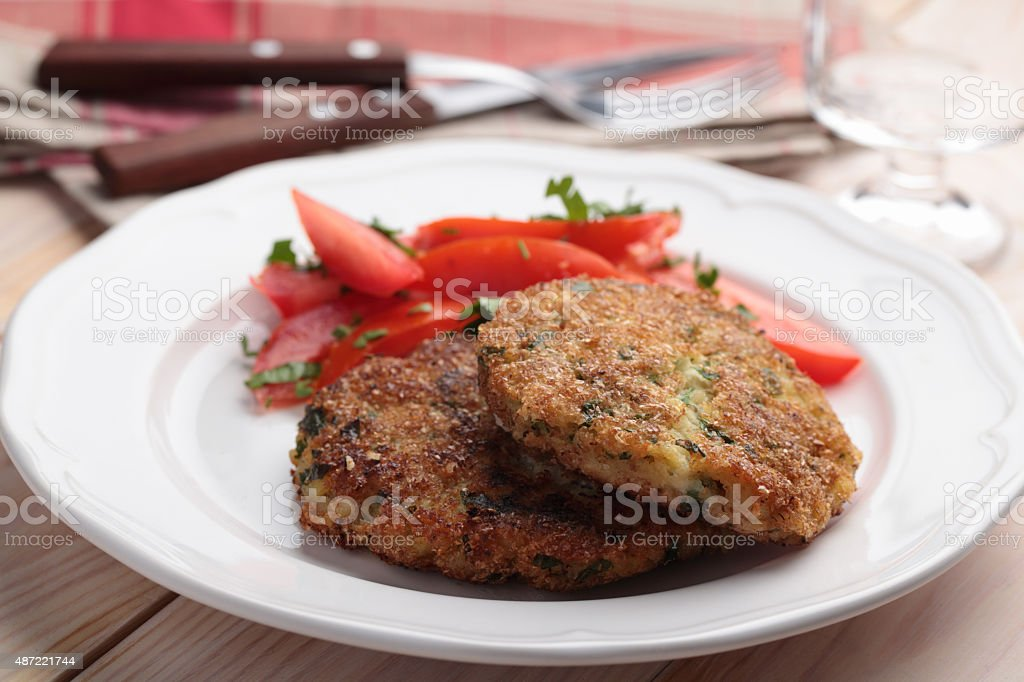Fish cakes with salad stock photo