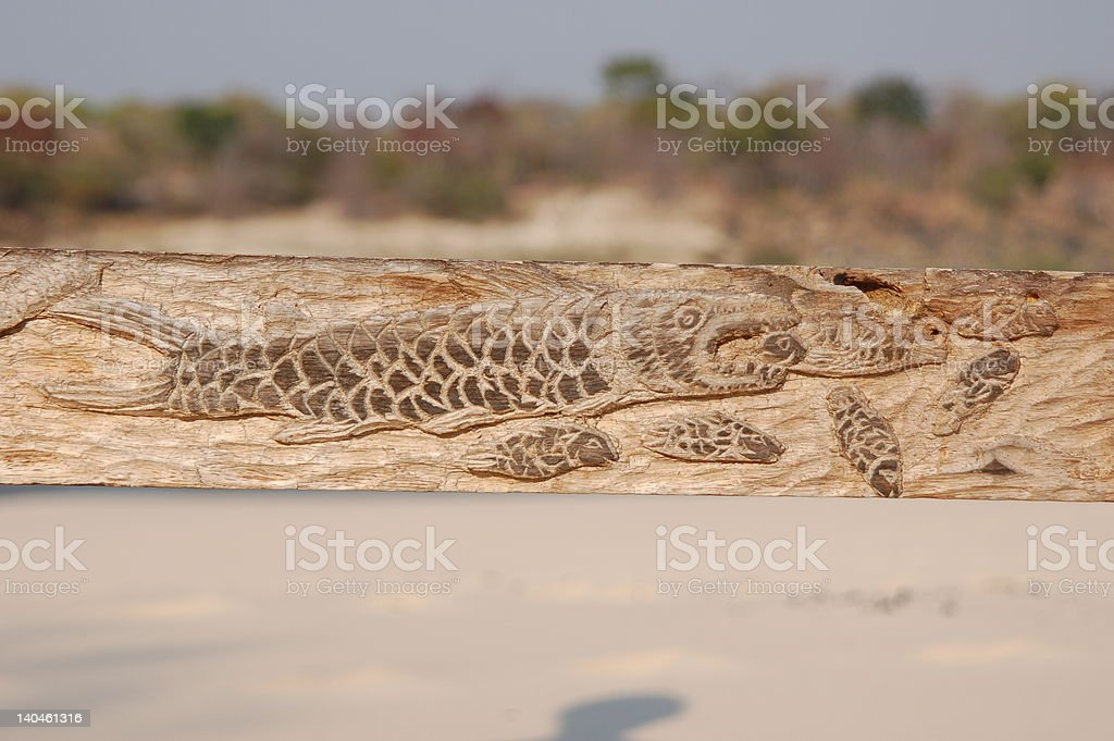 fish carved into old bench royalty-free stock photo