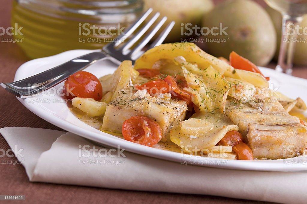 Fish, cherry tomatoes and potatoes. royalty-free stock photo