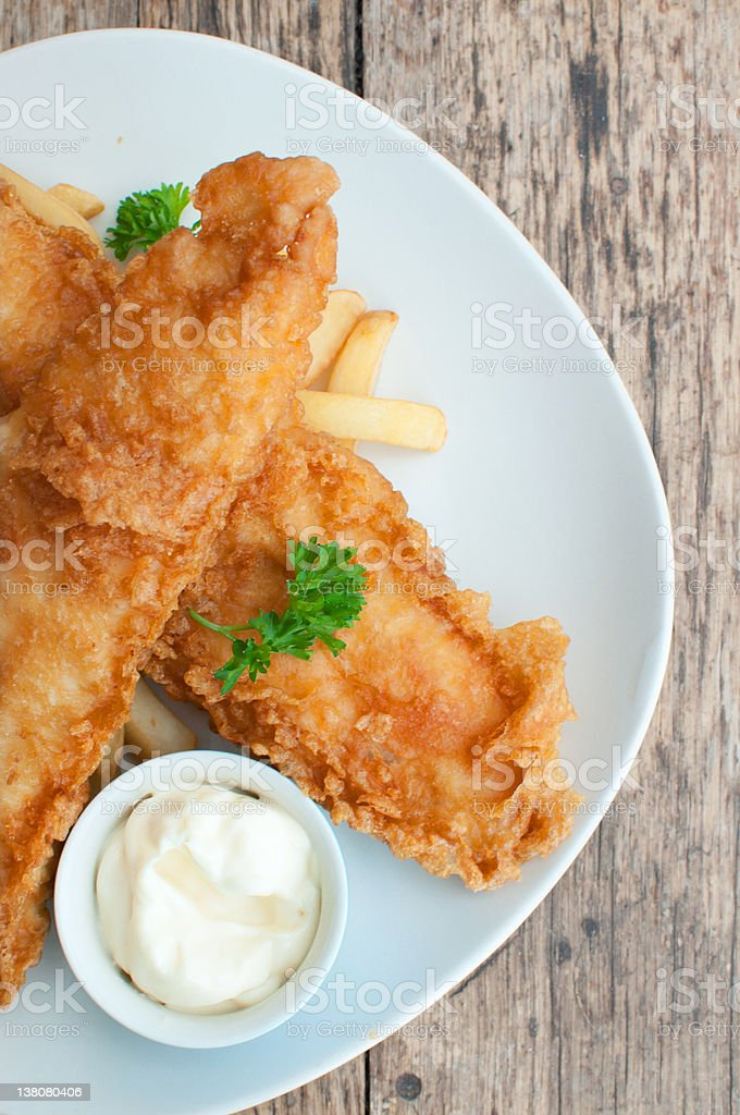 Fish, chips and dish of mayonnaise on white plate stock photo