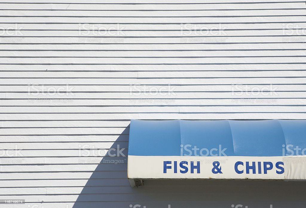 Fish & Chips sign and white siding royalty-free stock photo