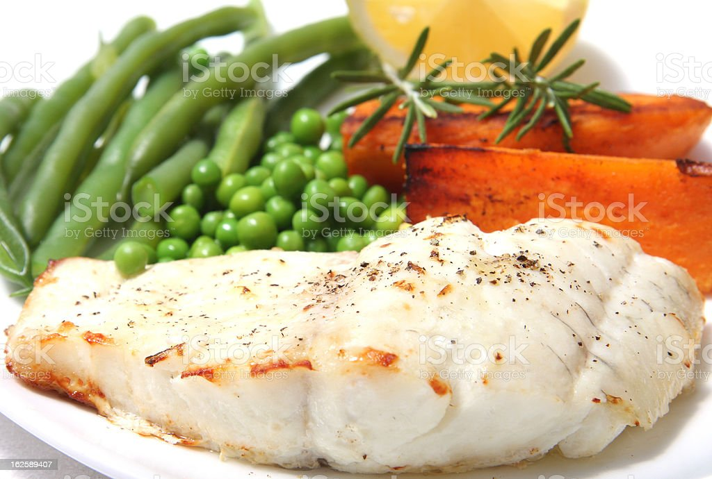 Fish cod and vegetables stock photo