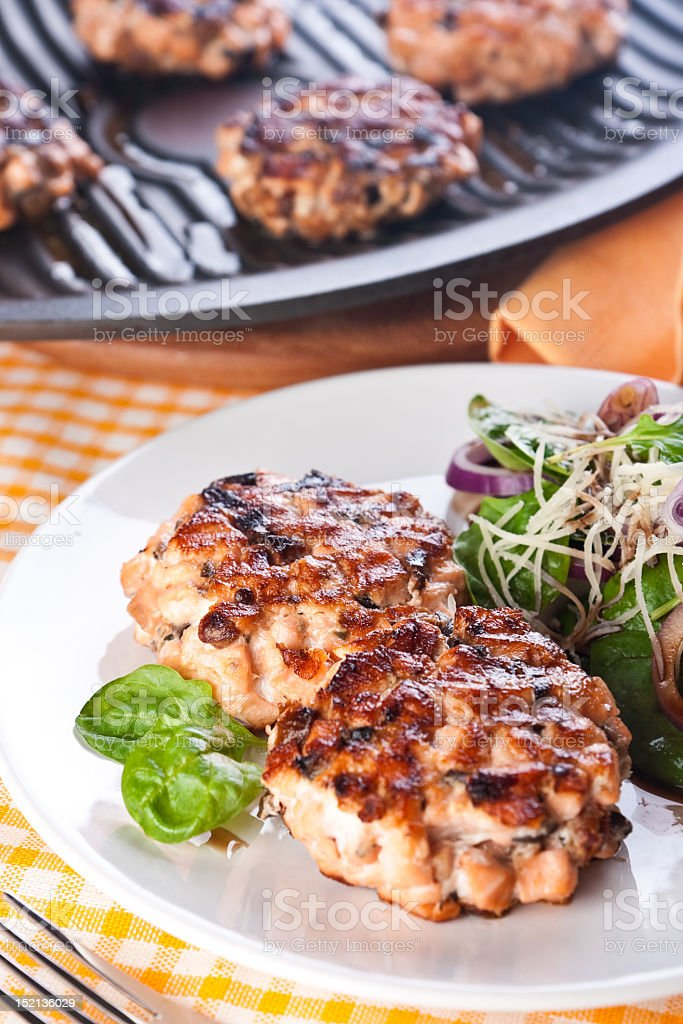 Fish cutlet with a salad of spinach and onion royalty-free stock photo