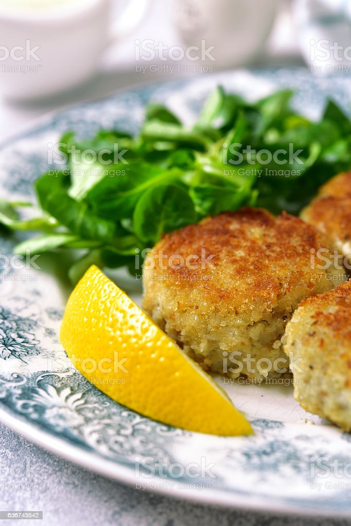 Fish cutlets with cream sauce on a vintage plate.Top view. stock photo