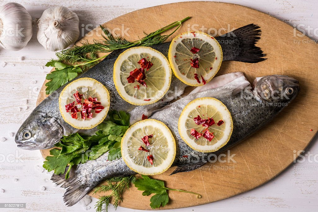Fish dish cooking with various ingredients. stock photo