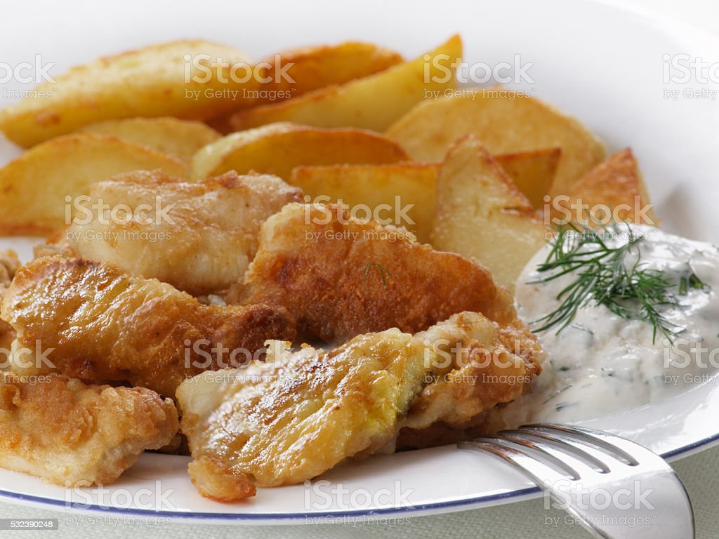 Fish dish - fried fish, fried potatoes and vegetables royalty-free stock photo
