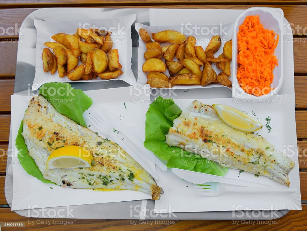 Fish dishes on the tray stock photo