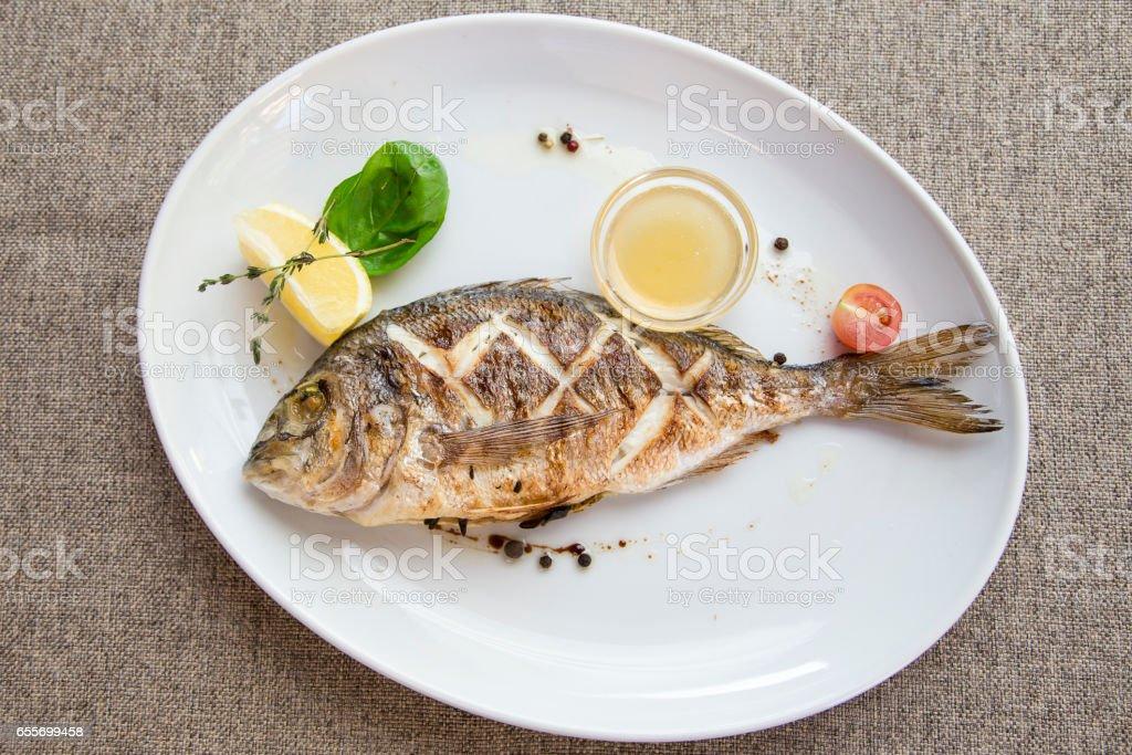 Fish dorado grille stock photo