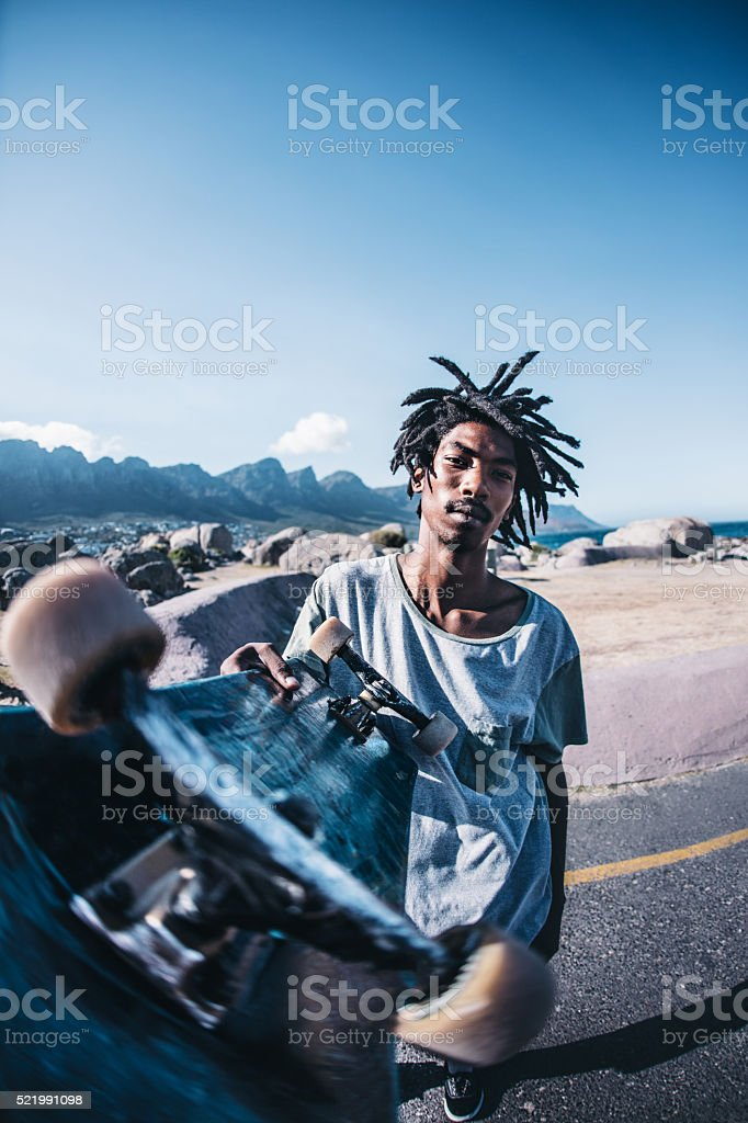 Fish Eye Lens Portrait of African American Holding Skateboard Ou stock photo