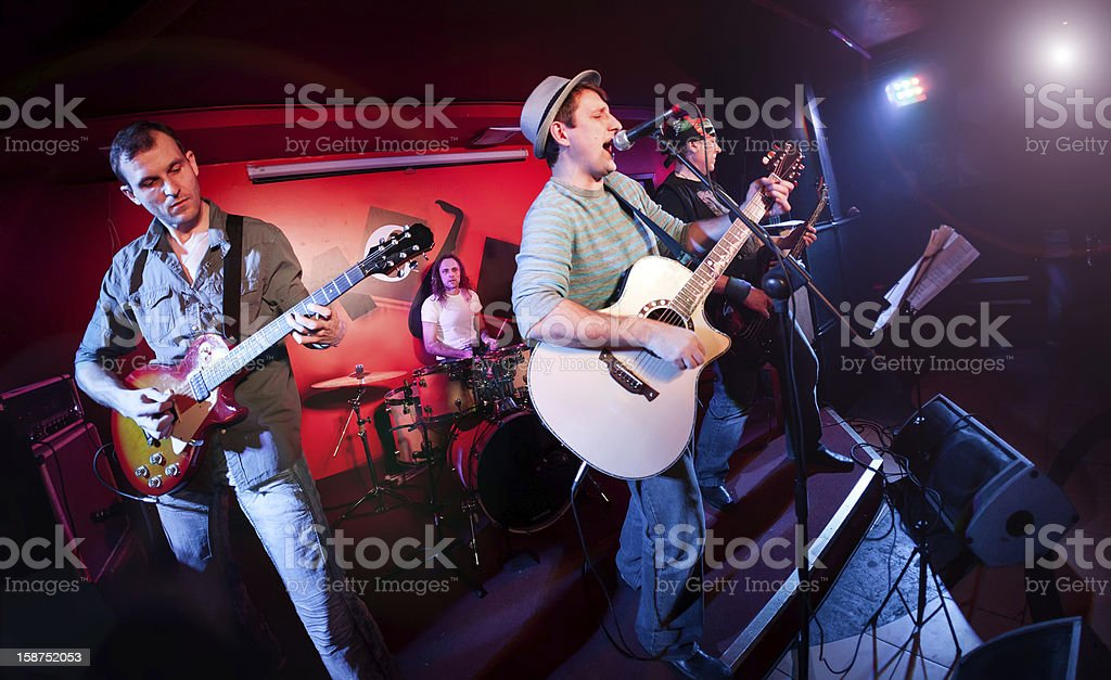 Fish eye photo of a band performing on stage royalty-free stock photo