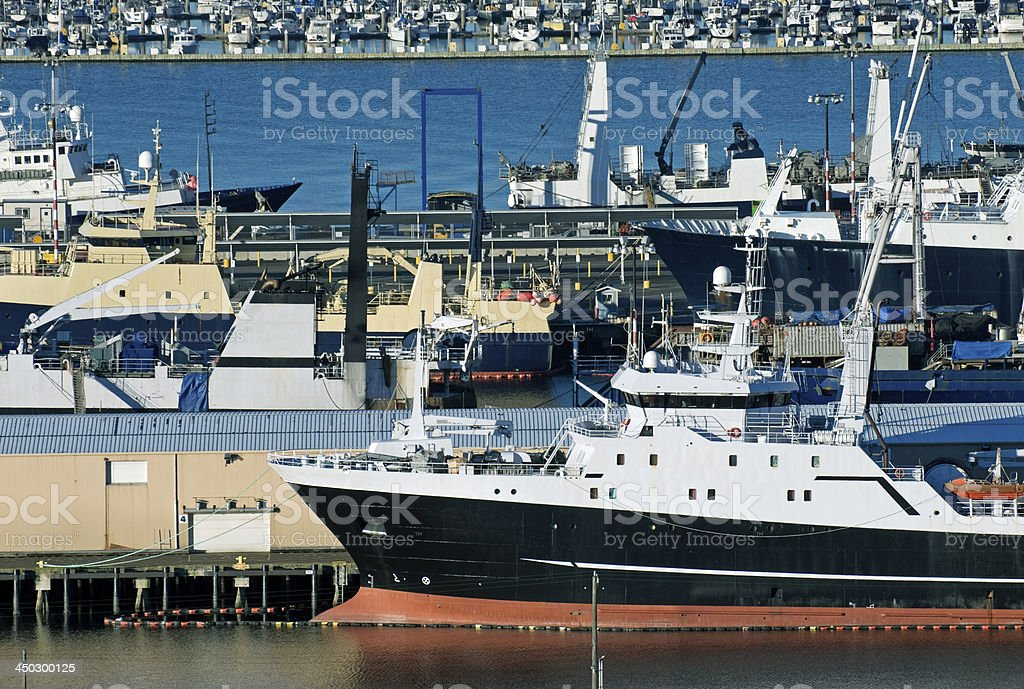 Fish factory ships at piers on Elliott Bay in Seattle stock photo