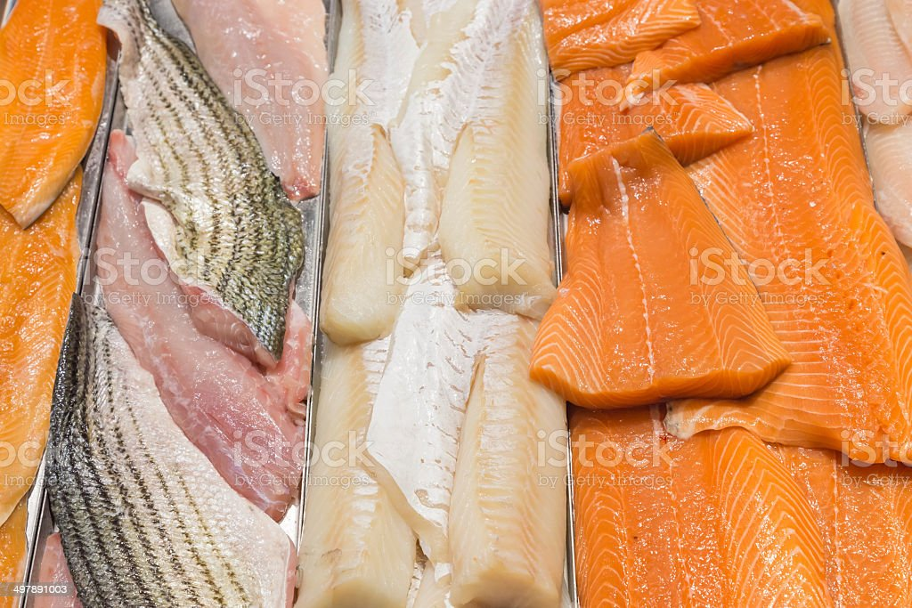 Fish filet on a stand in a local foodmarket stock photo