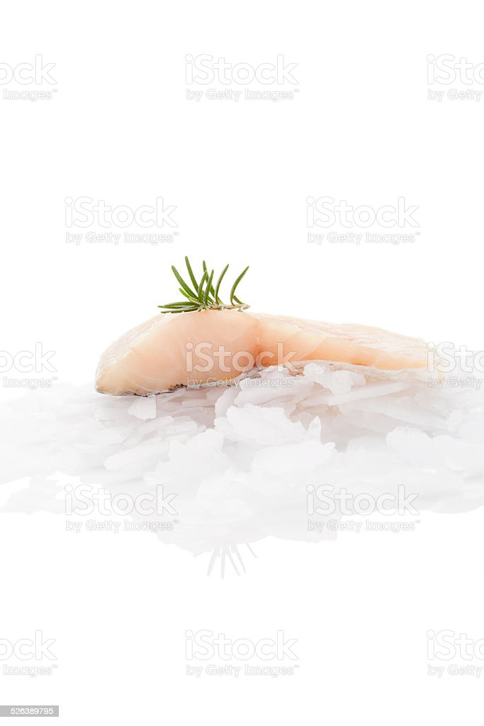 Fish fillet on ice isolated on white background. stock photo