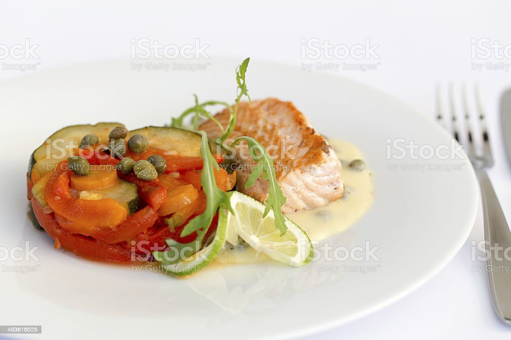 Fish fillet, sauce and vegetables stock photo