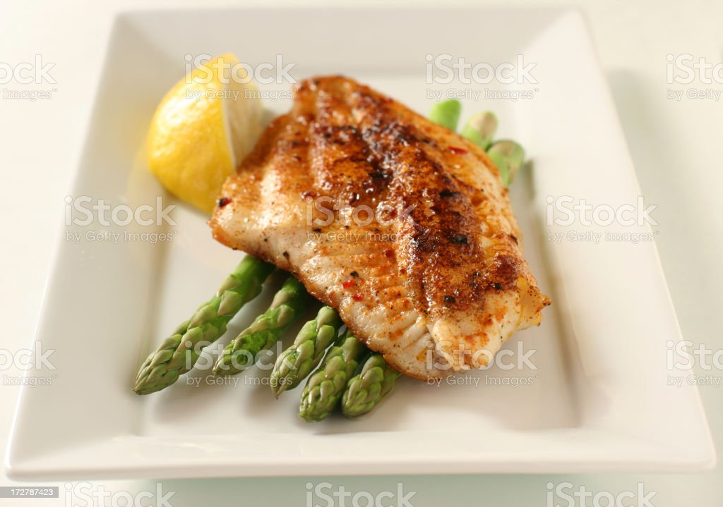 fish fillet with asparagus and lemon stock photo