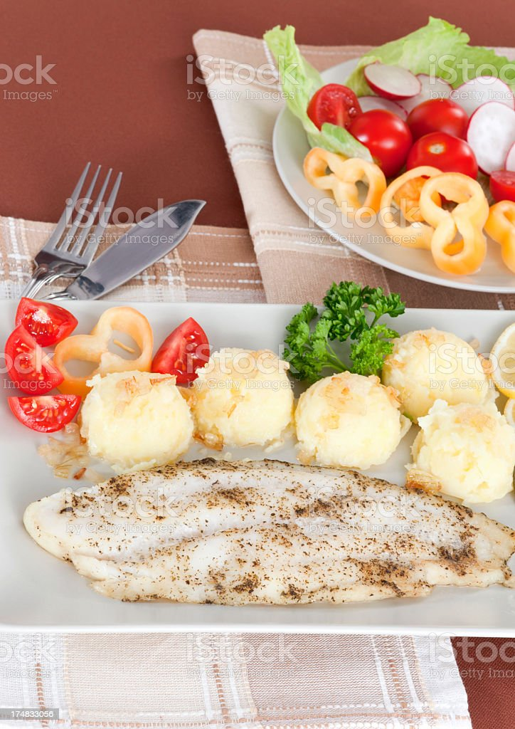Fish fillet with potatoes and vegetables royalty-free stock photo