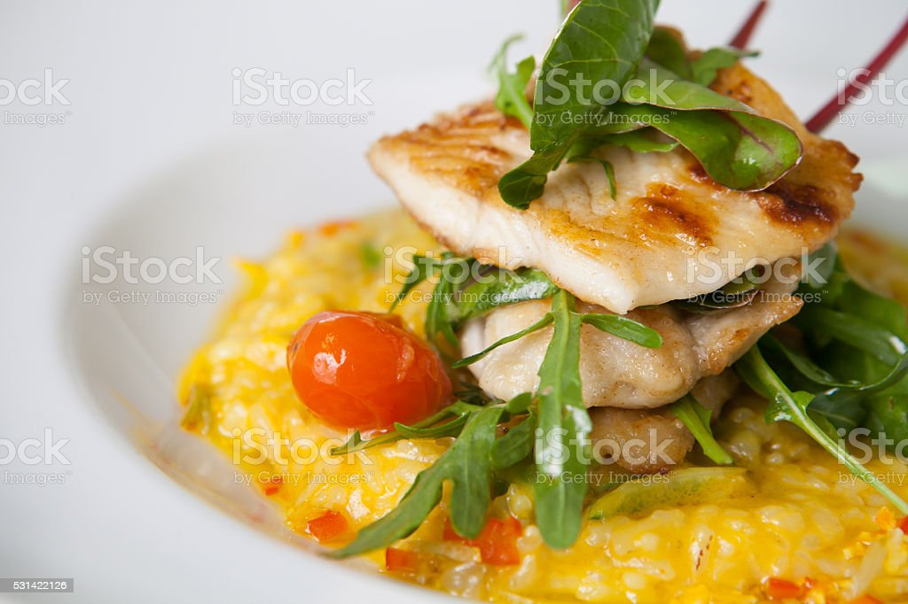 Fish fillet with risotto stock photo