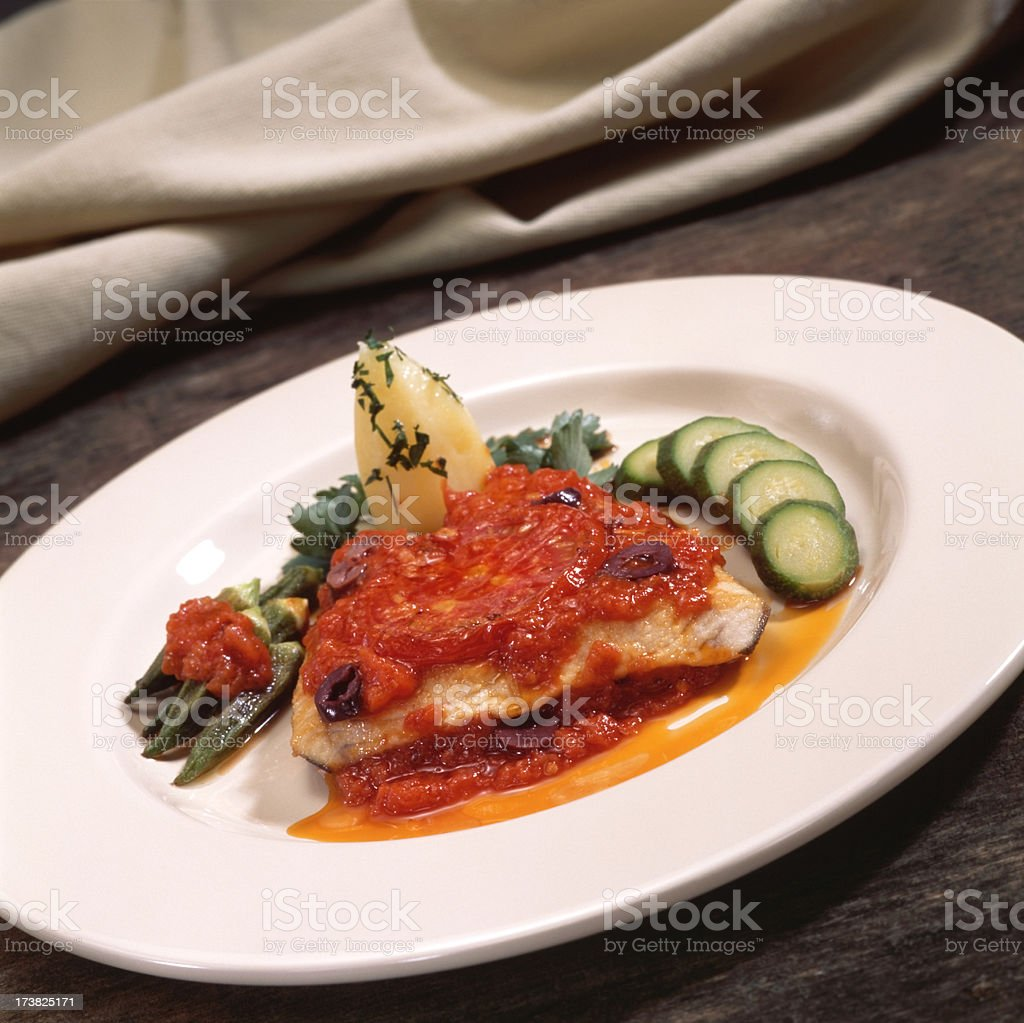Fish fillet with tomato sauce royalty-free stock photo