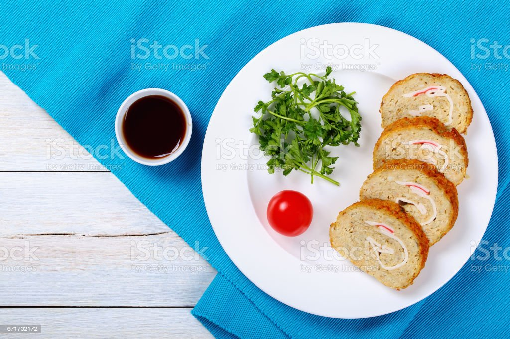 fish fillets roll-up with crab meat stock photo
