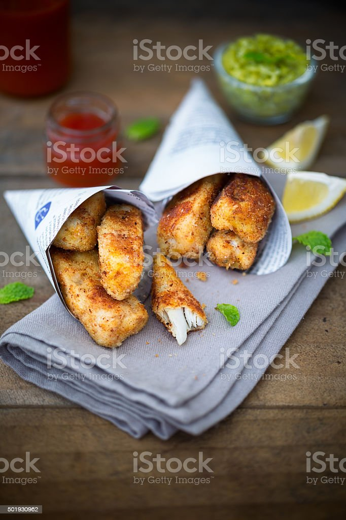 Fish finger with mashed peas stock photo