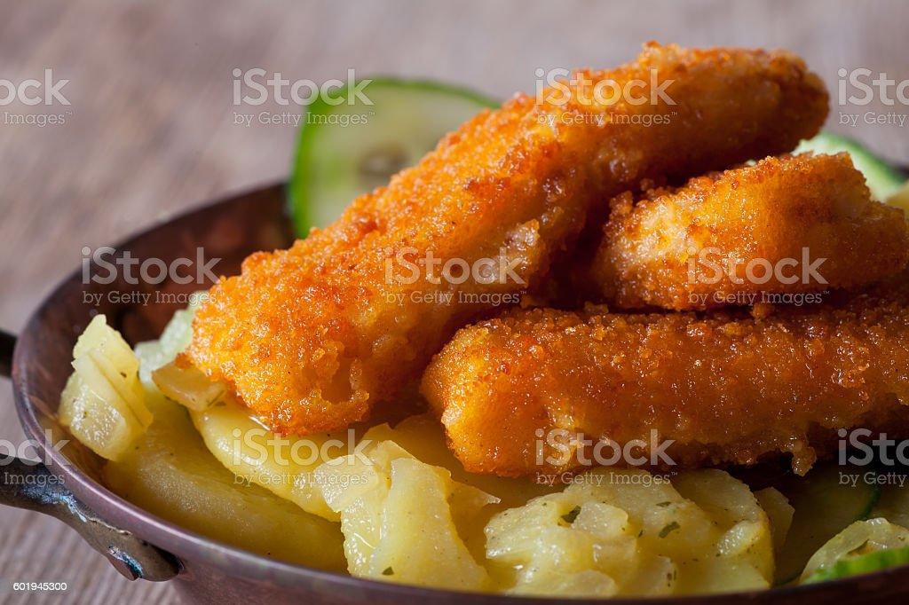 fish fingers and potato salad stock photo