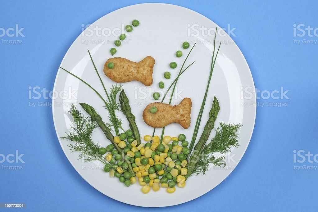 Fish fingers on a plate with vegetables royalty-free stock photo