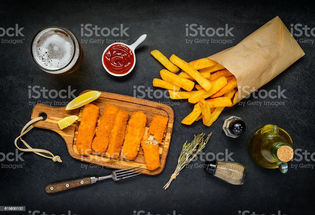 Fish Fingers with Paper Bag of French Fries stock photo