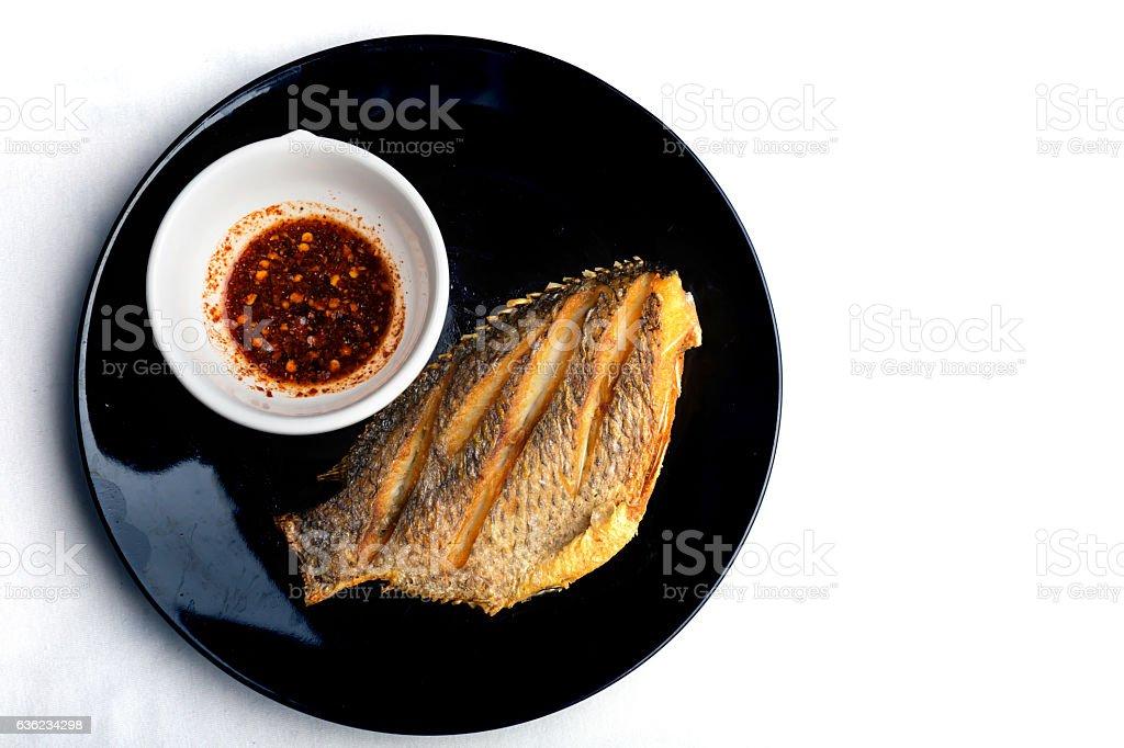 fish fry on black plate ,Tilapia Fish,planil. stock photo