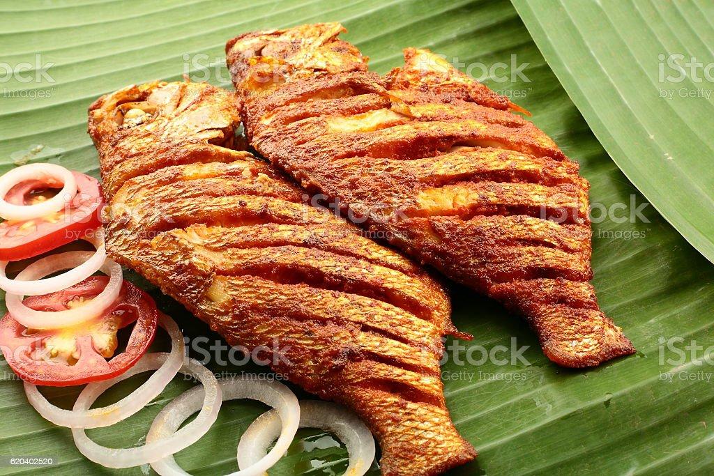 fish fry served on banana leaf, stock photo