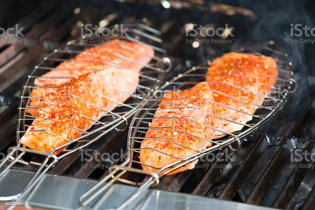 Fish Grill Clamp on BBQ stock photo