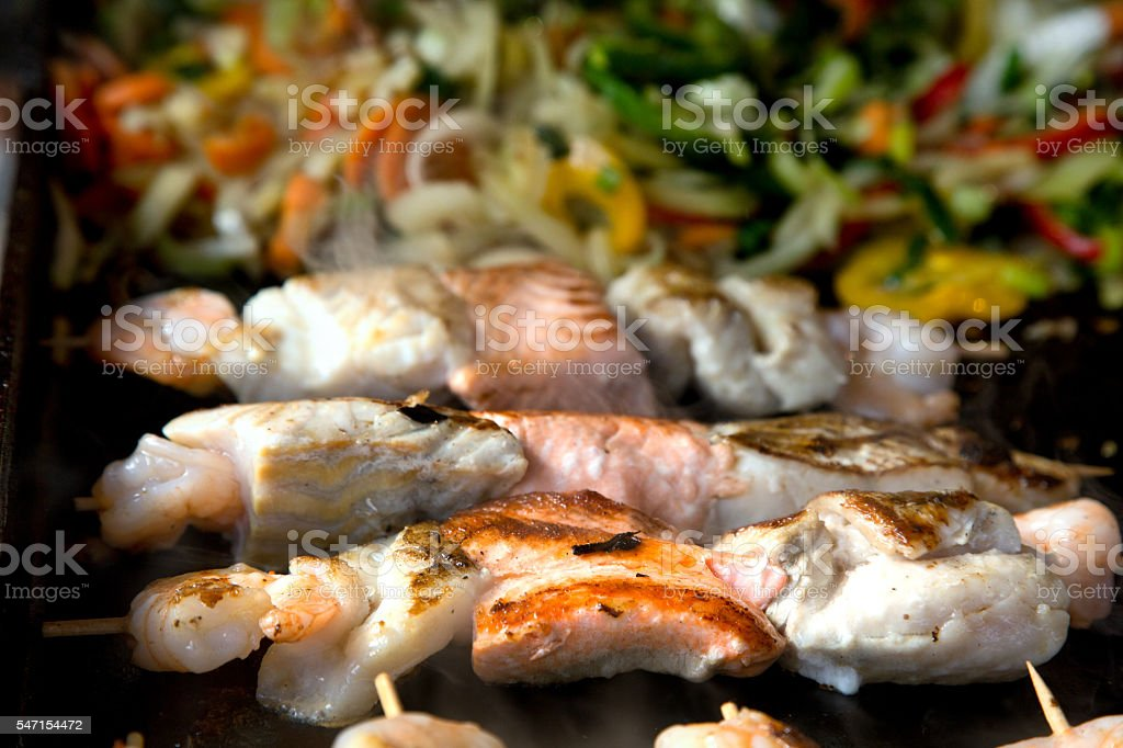 Fish Kebabs Over The Grill stock photo