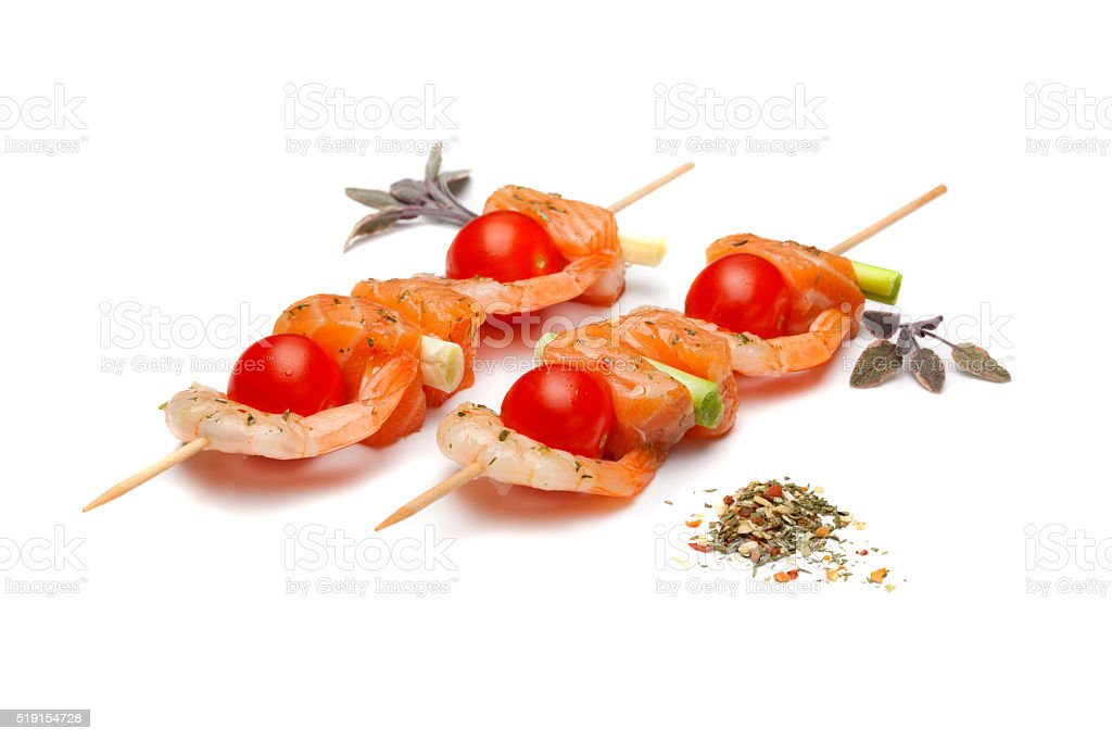 Fish kebabs with vegetables stock photo