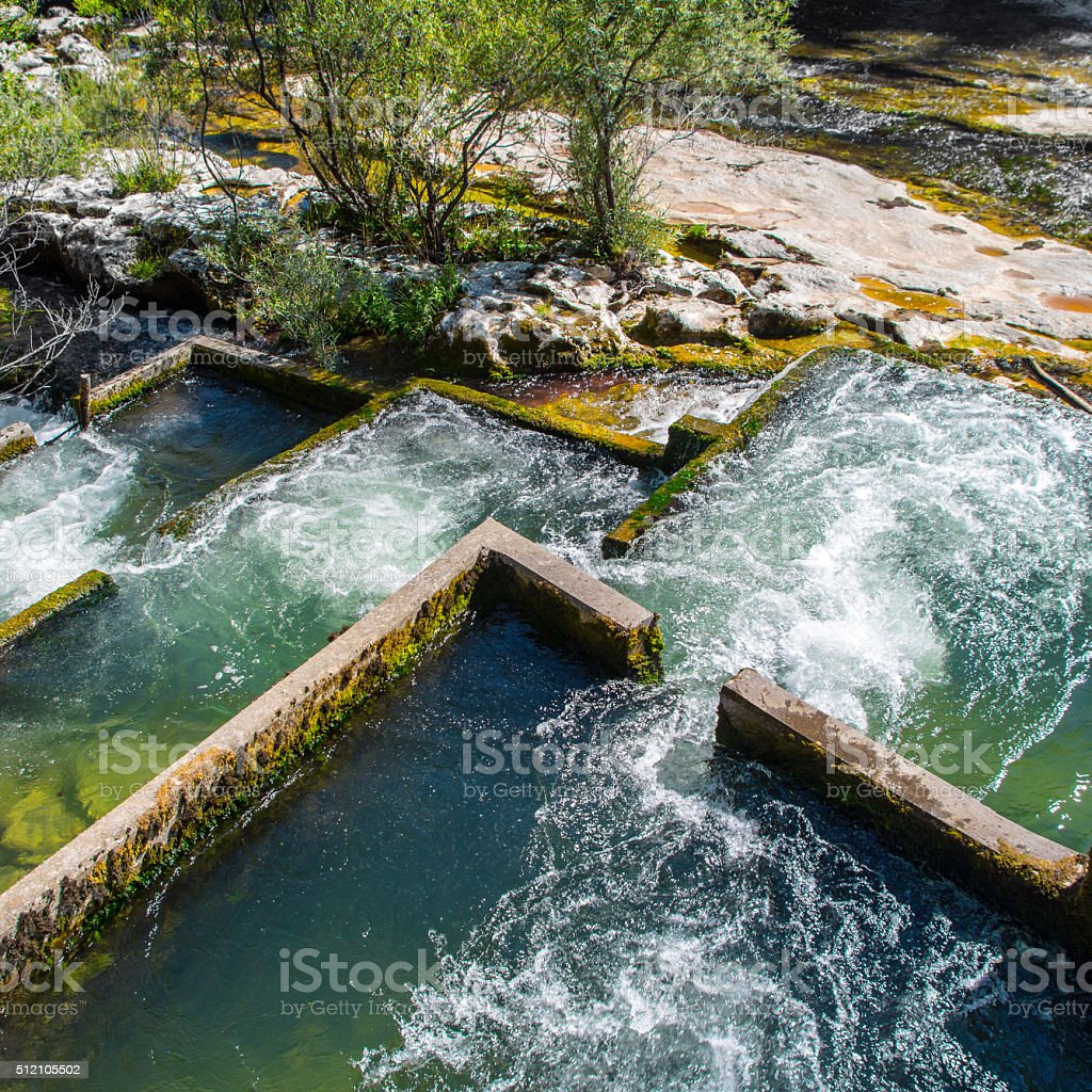 Fish ladder structure along Valserine wild river in France stock photo