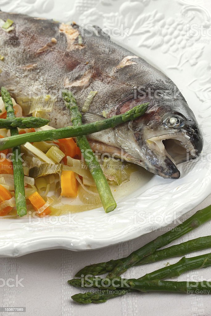 Fish, lake trout with young vegetables stock photo