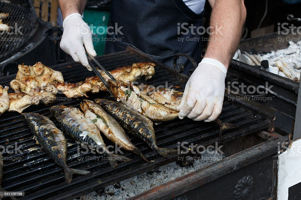 Fish mackerel and chicken tabaka grilled at bbq stock photo