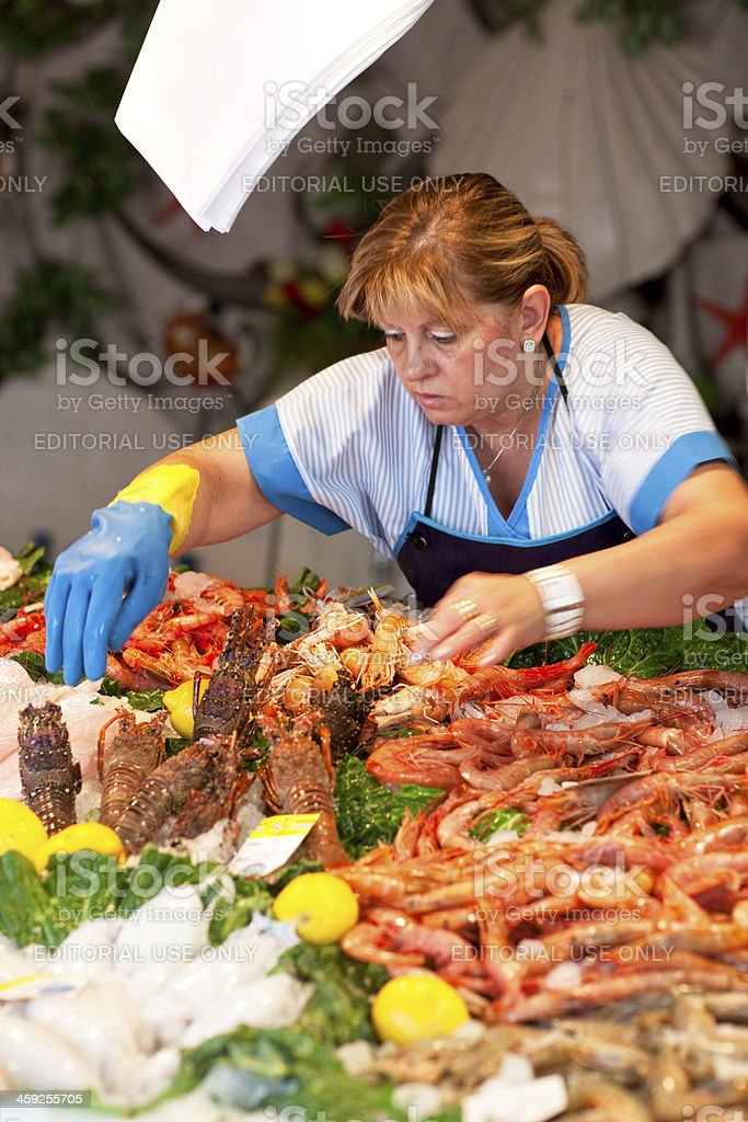 Fish market seller stock photo